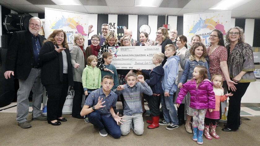 The Burbank Arts For All Foundation gave the Burbank Unified School District a check for $100,000 at