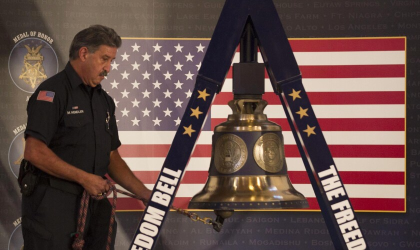 San Diego Fire Department firefighter-paramedic Mitch Mendler rang the Freedom Bell 343 times in remembrance of the NYFD firefighters who died on Sept. 11, 2001, during a remembrance ceremony at the Veterans Museum in Balboa Park on Sept. 11. The bell is now heading to Hawaii.