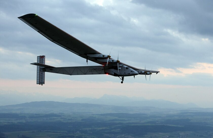 German test pilot Markus Scherdel steers the solar-powered Solar Impulse 2 aircraft for its maiden flight at its base in Payerne, Switzerland Monday, June 2, 2014. The aircraft is the second solar plane of the Solar Impulse project. The main goal of the project is to circumnavigate the world with an aircraft, powered only by solar energy. (AP Photo/Denis Balibouse,Pool)