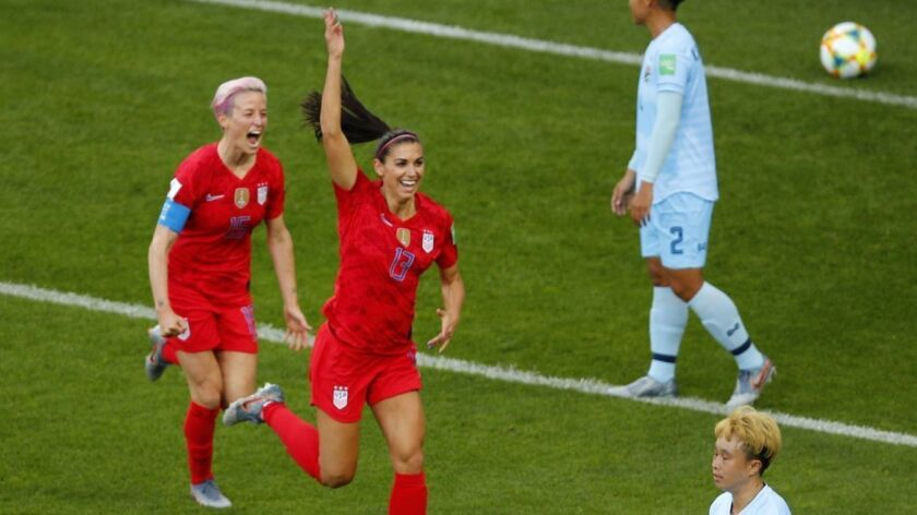 Alex Morgan, center, celebrates after scoring the first of her five record goals during a 13-0 victory for the U.S. over Thailand in a Group F match Tuesday at the Women's World Cup in Reims, France.