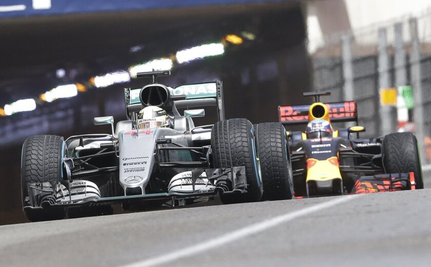 Mercedes driver Lewis Hamilton of Britain  leads Red Bull driver Daniel Ricciardo of Australia during the Formula One Grand Prix at the Monaco racetrack in Monaco, Sunday, May 29, 2016. (AP Photo/Claude Paris)