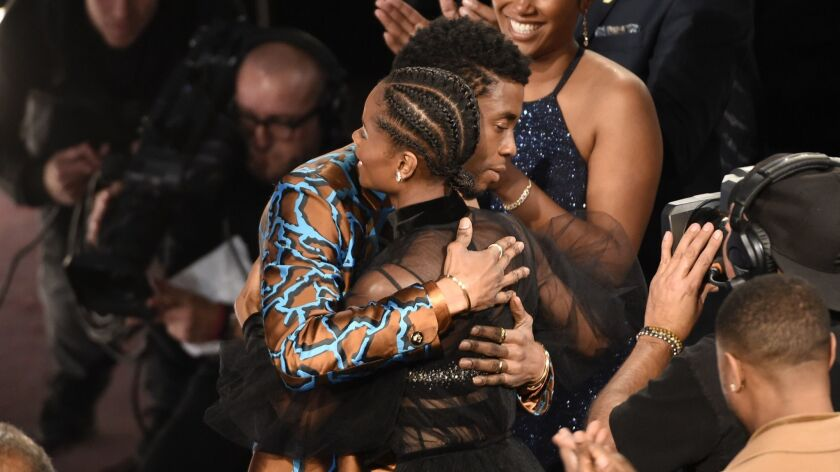 "Chadwick Boseman congratulates Letitia Wright before she goes onstage to accept the award for breakthrough performance in a motion picture for ""Black Panther"" at Saturday night's NAACP Image Awards."