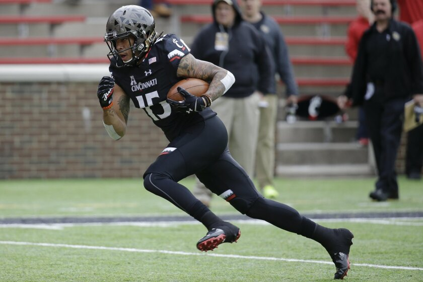 Cincinnati wide receiver Chris Moore runs for a touchdown in the first half of an NCAA college football game against UCF, Saturday, Oct. 31, 2015, in Cincinnati. (AP Photo/John Minchillo)