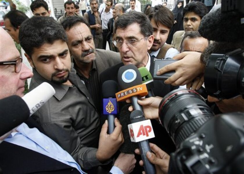 Reza Saberi, center, father of the Iranian-American journalist Roxana Saberi, who has been convicted of spying, talks with the media during his daughter's court of appeal hearing in Tehran, Sunday, May 10, 2009. An Iranian court of appeal on Sunday will review the case against an American journalist jailed in Iran for allegedly spying for the United States, the country's official news agency said. (AP Photo/Vahid Salemi)