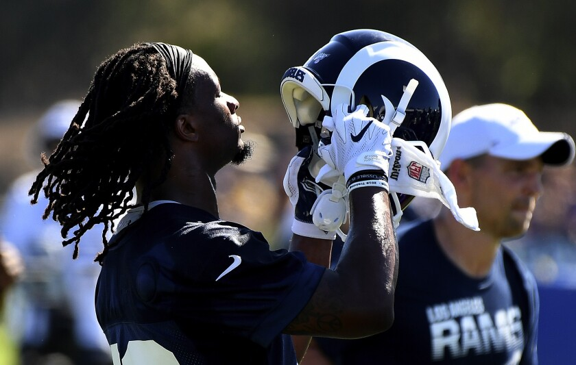Rams running back Todd Gurley puts on his helmet during a training camp practice session in July.