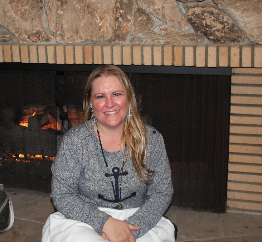 crystal-hinton-warms-up-at-the-yacht-club-fireplace-20190220