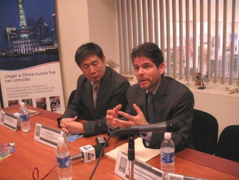 Gao Shoujian, the Chinese consul in Tijuana, listened Monday as Baja California's deputy tourism secretary, Ives Lelevier, discussed the planned resumption next March of the Tijuana-Shanghai Aeromexico flight.