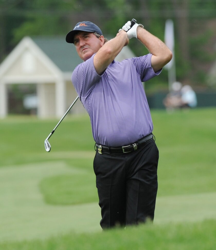 Gene Sauers hits from the 14th fairway during the first round of the Senior PGA Championship golf tournament at Harbor Shores in Benton Harbor, Mich. (Don CampbellThe Herald-Palladium via AP)