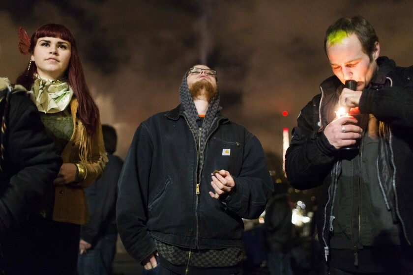 People celebrate marijuana legalization with a smoke out event in Seattle
