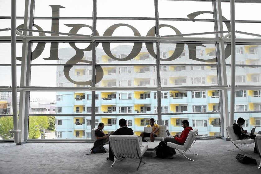 Alphabet has diversified into cloud services and gadgets, but advertising on Google still accounts for most of its revenue. Above, developers gather for a Google conference before the pandemic hit.
