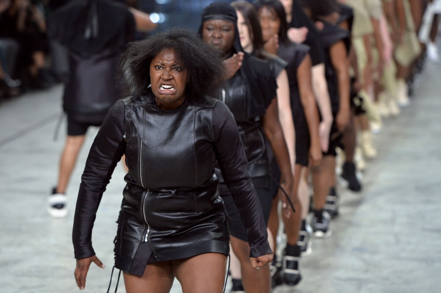 Models perform as they present creations by Rick Owens at spring/summer 2014 Paris Fashion Week.