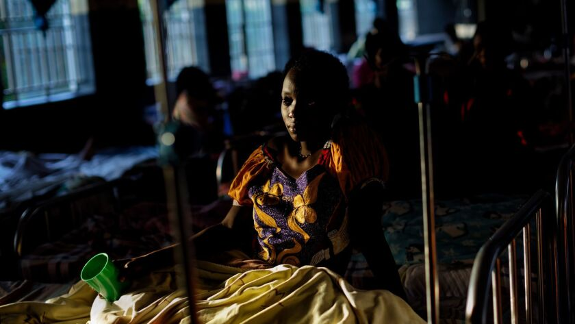 Expectant mothers lie on beds in the maternity ward of the Kalisizo General Hospital in Kalisizo, Uganda on May 31.