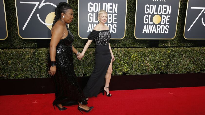 BEVERLY HILLS, CA - January 7, 2018 Tarana Burke and Michelle Williams arriving at the 75th Golde