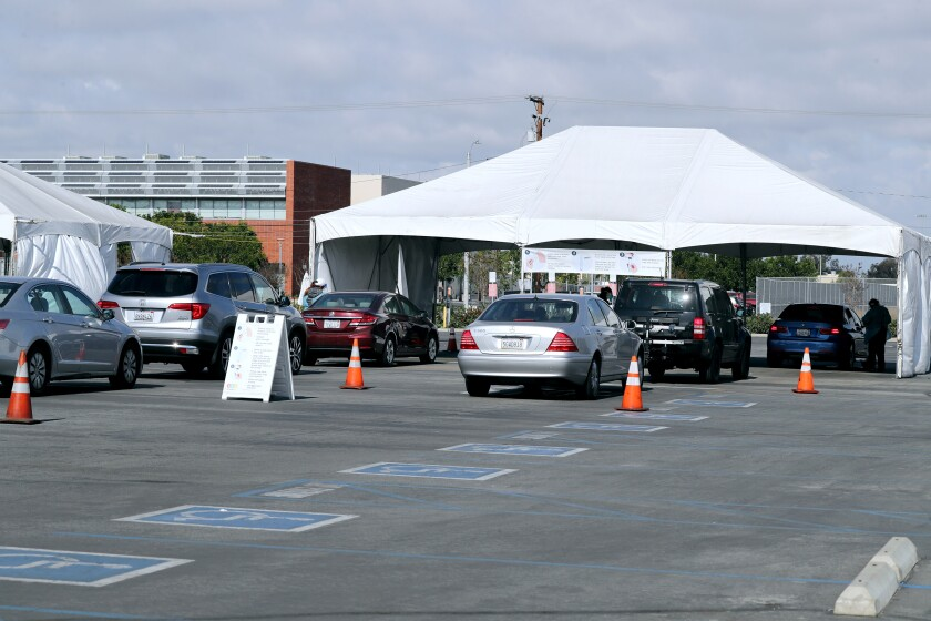 Vehicles line up at the COVID-19 testing super site at the Orange County Fair and Event Center in Costa Mesa on Jan. 22.