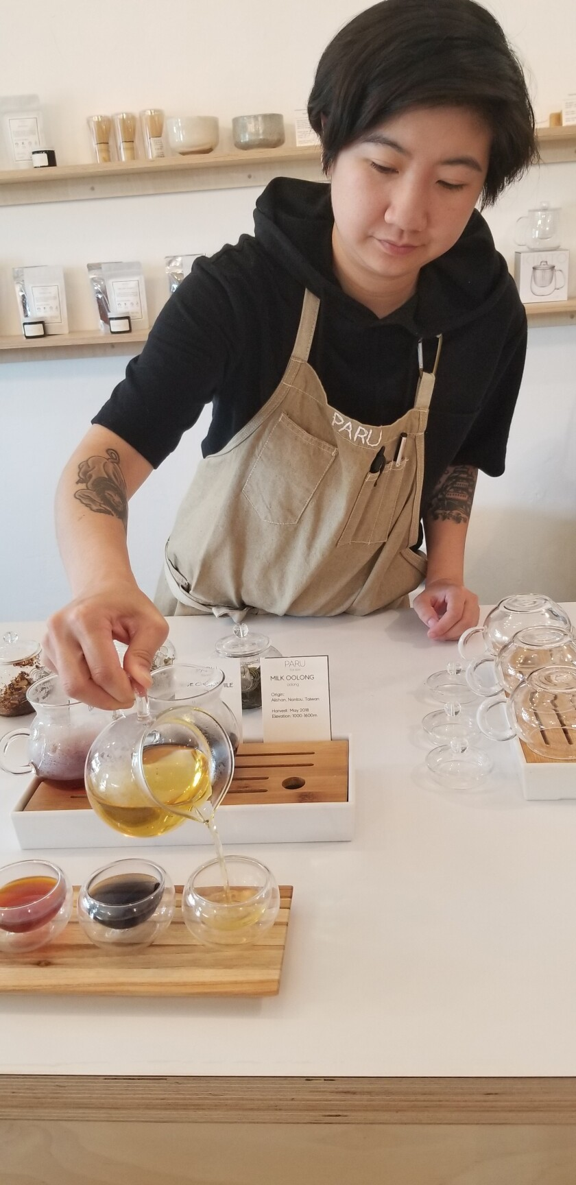 Amy Truong pours a cup of Milk Oolong tea.
