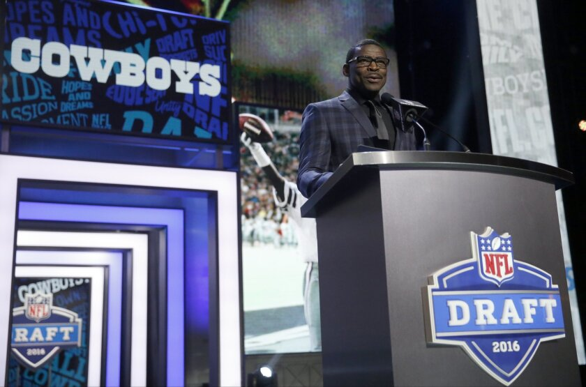Former NFL player Michael Irvin announces that the Dallas Cowboys selects Notre Dame's Jaylon Smith as the 34th pick in the second round of the 2016 NFL football draft, Friday, April 29, 2016, in Chicago. (AP Photo/Charles Rex Arbogast)