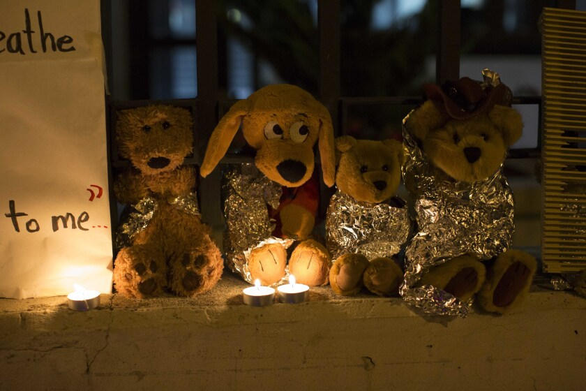 FILE - In this Wednesday, June 20, 2018, file photo, stuffed toy animals wrapped in aluminum foil representing migrant children separated from their families are displayed in protest in front of the United States embassy in Guatemala City. In a report released Tuesday, June 8, 2021, the Biden administration says it has identified more than 3,900 children separated at the border under former President Donald Trump's 'zero-tolerance' policy on illegal crossings. (AP Photo/Luis Soto, File)