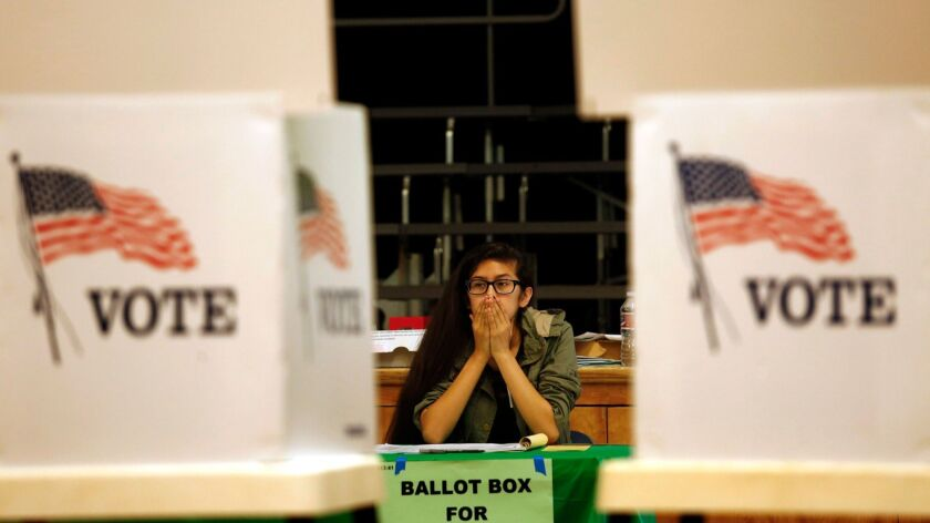 Election clerk Valerie Acosta waits for primary voters at the Kenter Canyon Elementary Charter School Auditorium in Los Angeles on June 7, 2016.
