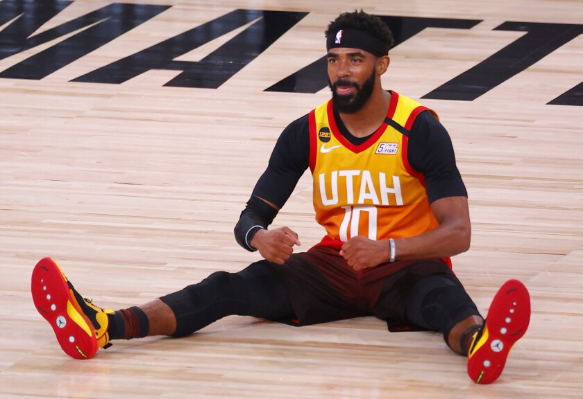The Jazz's Mike Conley reacts after being fouled during Game 3 of a playoff series against the Nuggets on Aug. 21, 2020.
