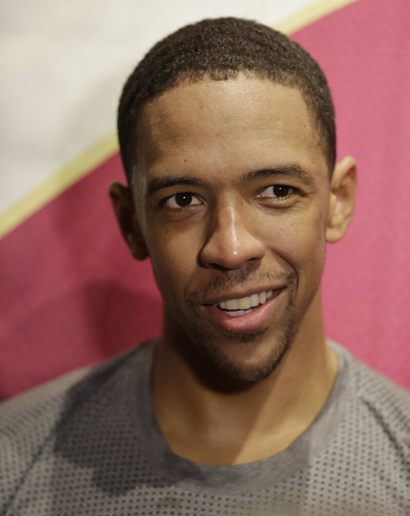 Cleveland Cavaliers' Channing Frye talks with members of the media before an NBA basketball game against the Detroit Pistons, Monday, Feb. 22, 2016, in Cleveland. Frye has passed his final medical tests and is expected to make his debut against Detroit. Frye was obtained last week in a three-team trade from Orlando. (AP Photo/Tony Dejak)