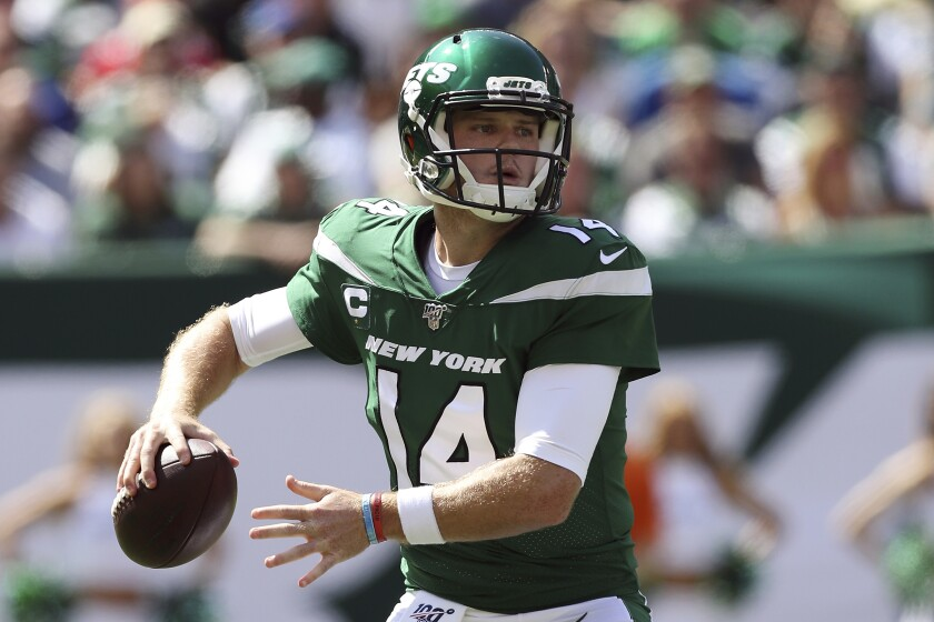 FILE - In this Sept. 8, 2019, file photo, New York Jets quarterback Sam Darnold (14) makes a pass during an NFL football game against the Buffalo Bills, in East Rutherford, N.J. Jets quarterback Sam Darnold was uncertain to return this week as he continued to recover from mononucleosis, which sidelined him the past two games. Jets coach Adam Gase said the team could potentially wait until Sunday to decide if Darnold or practice squad QB-turned-starter Luke Falk will be under center against the Eagles. (AP Photo/Steve Luciano, File)