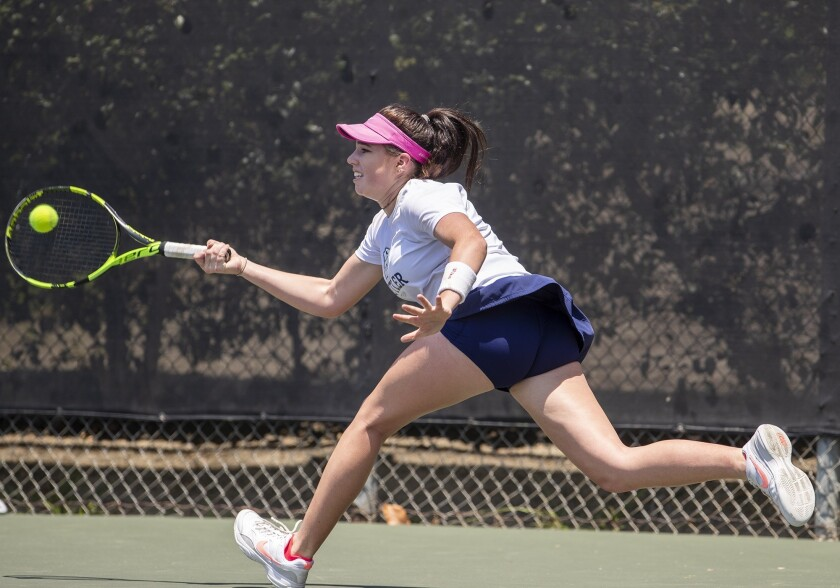 Roxy MacKenzie of Newport Coast returns a shot to Erica Ekstrand of Santa Monica in the girls' 18
