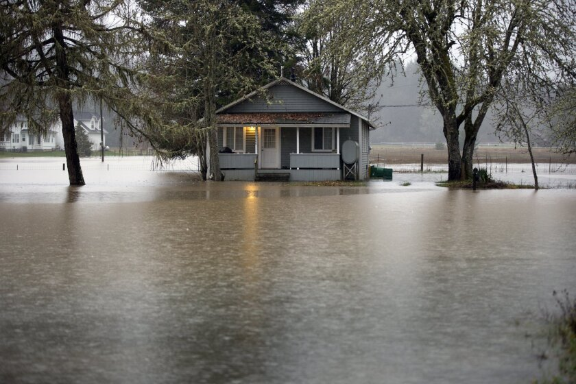 A home is flooded along Oregon 47 from the Nehalem River on Wednesday.