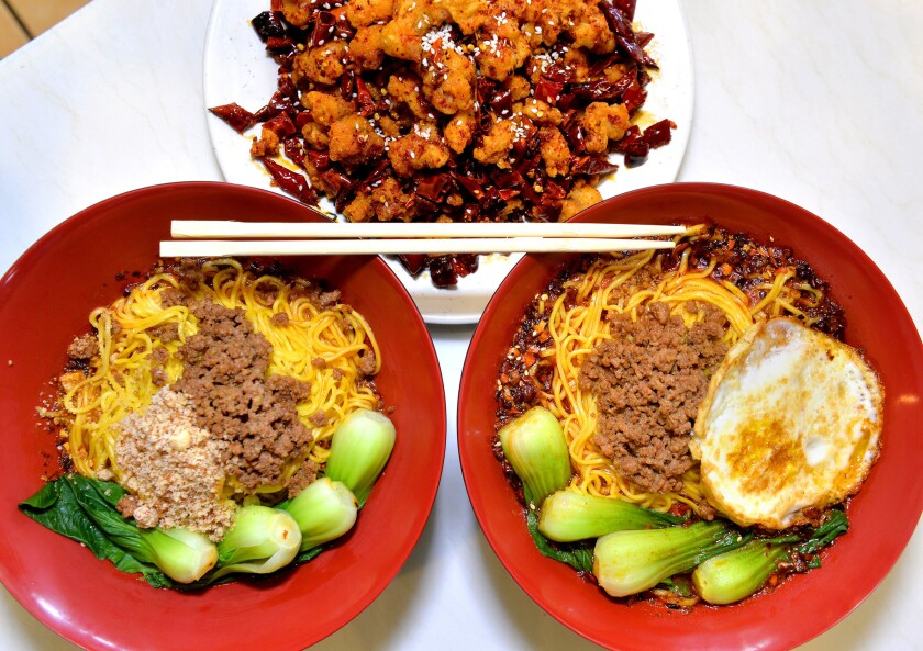 Some of the dishes available at Chong Qing Special Noodles in San Gabriel are fried chicken with chilies, top, dandan mian noodles, left, and Chongqing noodles, right.