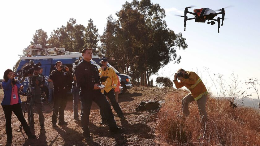 LAFD firefighter Derrick Ward flies a drone used in the Skirball Fire, to provide post-fire damage assessment and infrared capability to identify remaining hot spots.