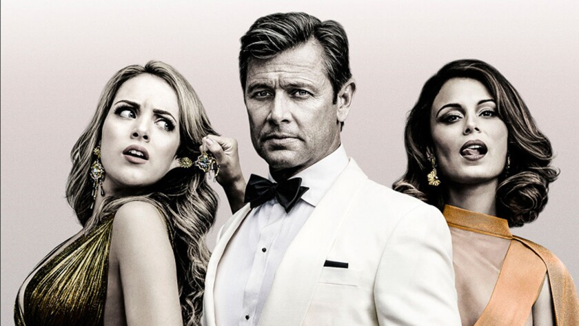 """Elizabeth Gillies as Fallon Carrington, Grant Show as Blake Carrington and Nathalie Kelley as Cristal Flores in a gallery shot for the CW's reboot of """"Dynasty."""""""