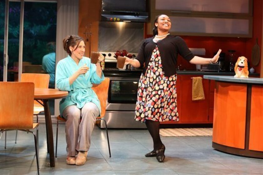 """This undated theater image released by the O and M Co., shows Farah Alvin, left, and Natalie Venetia Belcon in the Off-Broadway musical """"The Last Smoker in America,"""" appearing at the Westside Theatre in New York. (AP Photo/The O and M Co., Joan Marcus)"""
