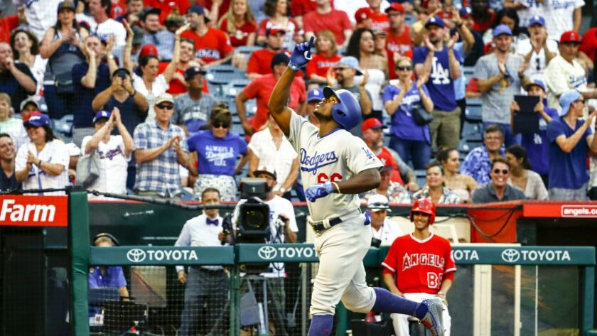 Los Angeles Dodgers right fielder Yasiel Puig (66) celebrates a home run in the ninth inning against the Angels.