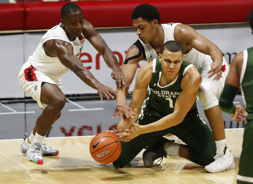 SDSU's Terrell Gomez and Matt Mitchell defend against Colorado State's John Tonje in a January game at Viejas Arena.