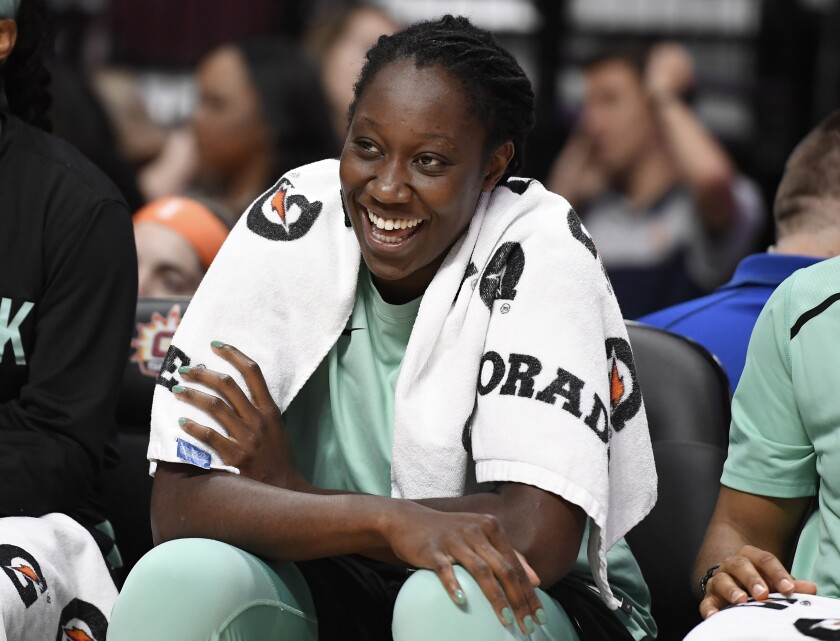 FILE - In this May 14, 2019, file photo, New York Liberty's Tina Charles smiles on the bench during the second half of a preseason WNBA basketball game in Uncasville, Conn. Several WNBA colleagues continue to be active in the fight against social injustice and police brutality, participating in protests and continuing work that they began four years ago. Charles, Natasha Cloud and others have been working toward solutions since 2016 after police shootings in Minnesota and another in Baton Rouge, Louisiana, made national headlines that year.(AP Photo/Jessica Hill, File)