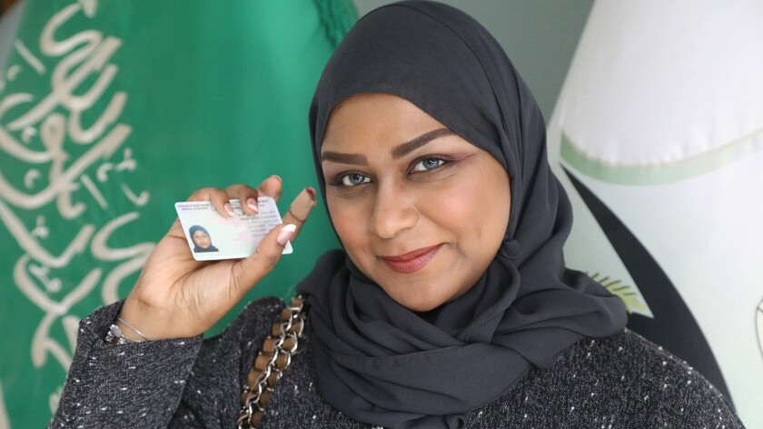 "Sarah Saleh holds up her driver's license in ""Saudi Women's Driving School "" on HBO."