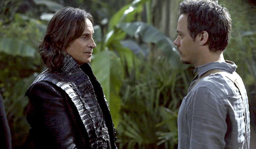 Rumpelstiltskin (Robert Carlyle, left) and Neal (Michael Raymond-James) discuss their shared foe, Peter Pan.