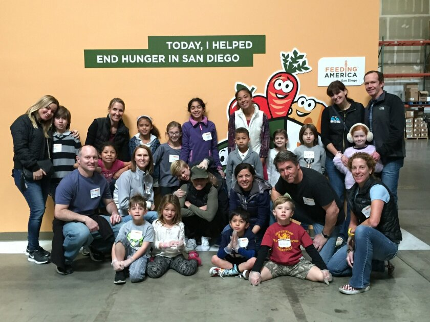 Del Mar Heights families recently volunteered at Feeding America San Diego. Jason, Crystal and Rebecca Conner pictured at left in middle row.