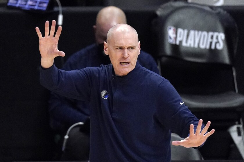 FILE - In this May 22, 2021, file photo, Dallas Mavericks head coach Rick Carlisle gestures during the second half in Game 1 of an NBA basketball first-round playoff series against the Los Angeles Clippers in Los Angeles. Carlisle stepped down as coach of the Mavericks on Thursday, June 17, 2021, the second major departure for that franchise in as many days. (AP Photo/Mark J. Terrill, File)