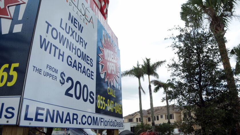 A sign in Tamarac, Fla., advertises Lennar Corp. town homes.