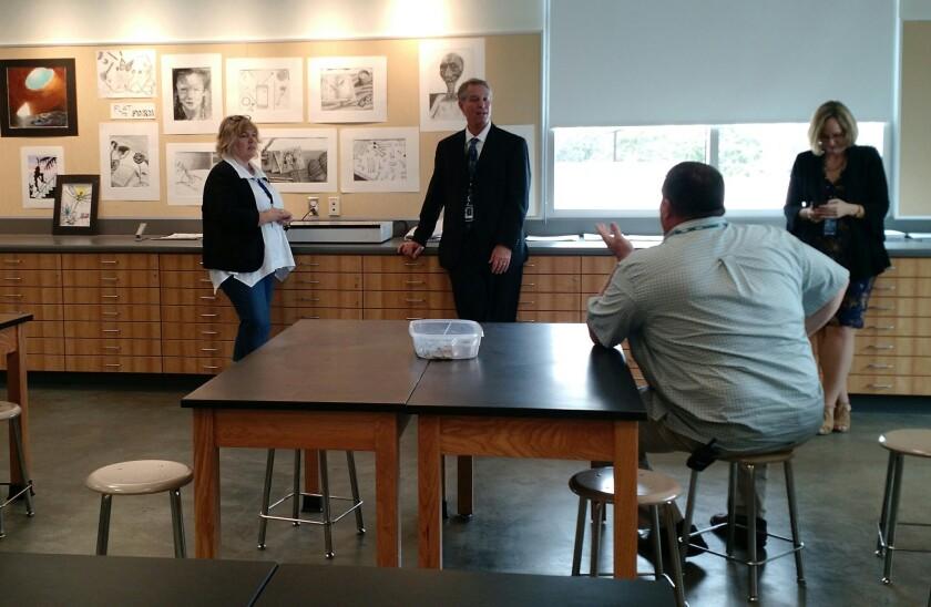 Grossmont high school district Superintendent Tim Glover, center, talks to Grossmont high Principal Dan Barnes, art department chair Susan Phillips, left, and the district's PIO Catherine Martin.