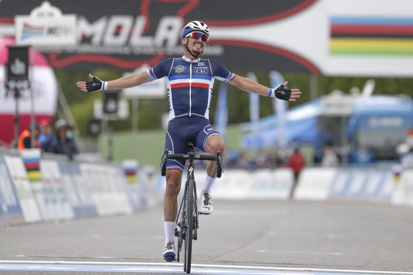 France's Julian Alaphilippe celebrates after winning the men's elite event, at the road cycling World Championships, in Imola, Italy, Sunday, Sept. 27, 2020. (AP Photo/Andrew Medichini)