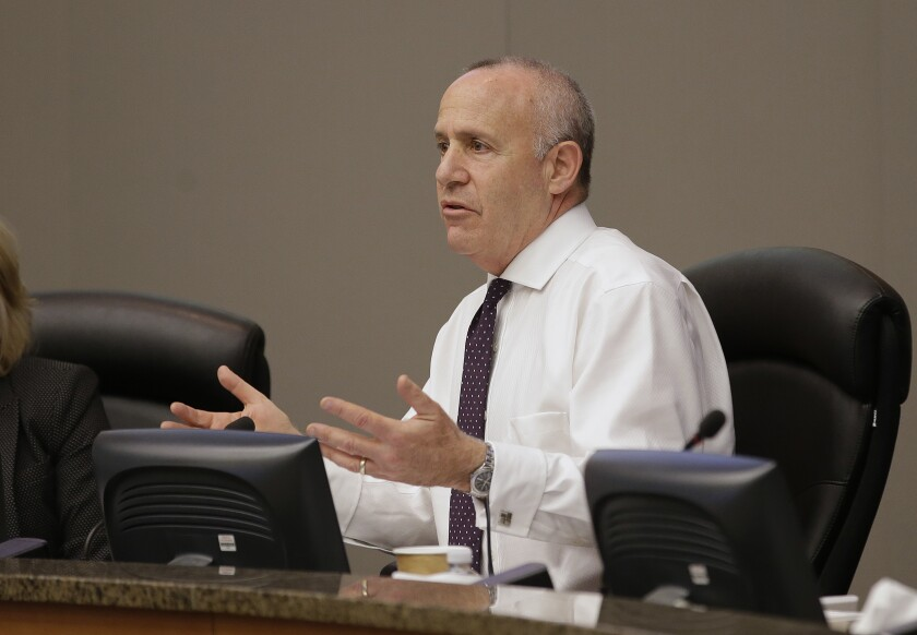 """FILE - In this April 10, 2018, file photo, Sacramento, Calif., Mayor Darrell Steinberg asks question during a meeting of the city council in Sacramento, Calif. Mayors in several of California's major cities steered away from calls to defund police budgets Wednesday, June 10, 2020, and instead promised to work for reforms that would examine how police are deployed and go about their jobs in their communities. Steinberg said a moment has arrived to fundamentally examine """"what do we actually expect our police officers to do, and what do we want them not to do?"""" (AP Photo/Rich Pedroncelli, File)"""