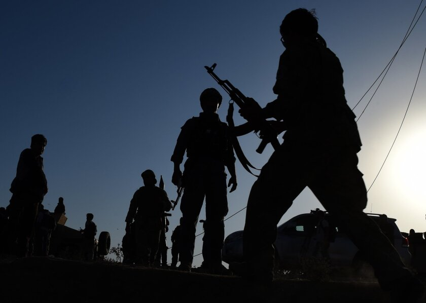 In Kunduz, Afghan military personnel patrol during fighting between Taliban militants and security forces in early October. The fighting in Kunduz underscored the deep security woes in Afghanistan that have eroded confidence in the government, according to polls.