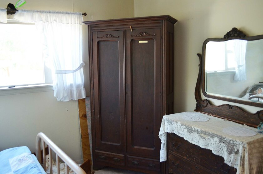 A room in the historical Teten house, with an original armoire.