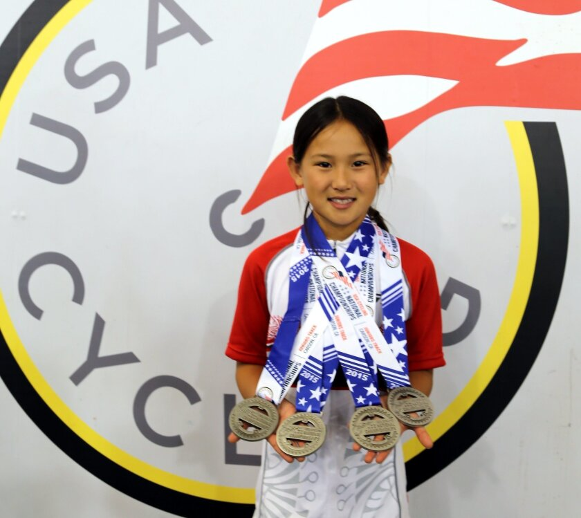 Natalie Wang, 9, a fourth-grader at Carmel Del Mar Elementary, with her four silver medals at the USA Cycling Elite and Junior Track National Championships.