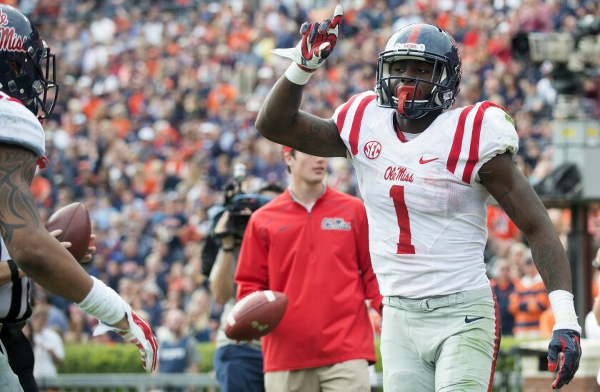 Mississippi wide receiver Laquon Treadwell celebrates after scoring a touchdown over Auburn defensive back Carlton Davis (18) during the fourth quarter of an NCAA college football game on Saturday, Oct. 31, 2015, in Auburn, Ala. (Albert Cesare/The Montgomery Advertiser via AP)  NO SALES; MANDATORY