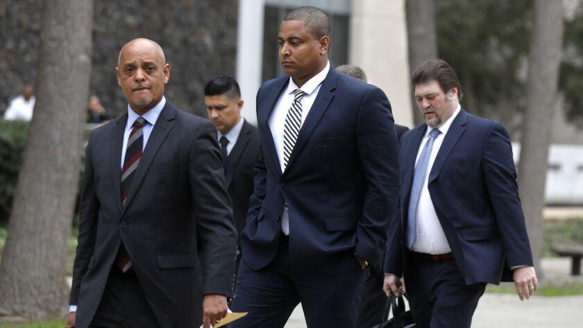 MARCH 20, 2018,VAN NUYS, CA--Jonathan Martin, center, walks with his attorney Winston McKesson, left