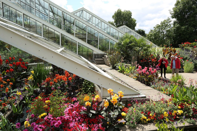 Visitors enjoy a break from the rain at Kew Gardens in London.