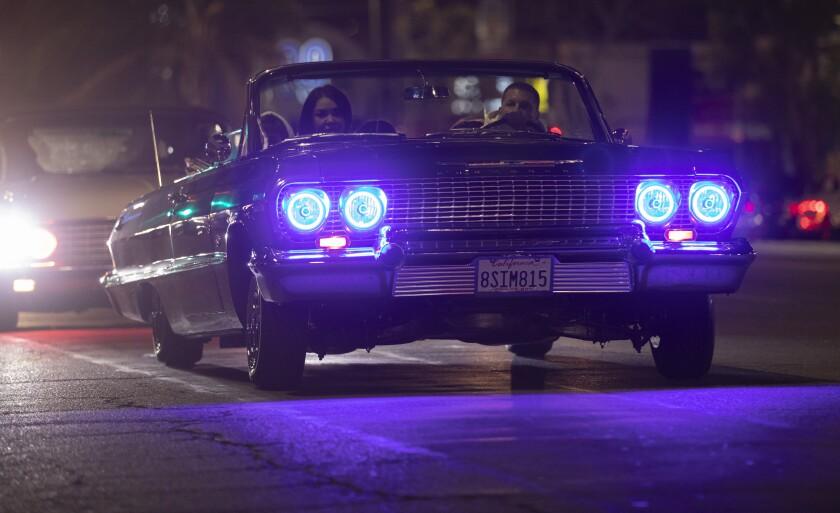 A lowrider cruises Van Nuys Boulevard