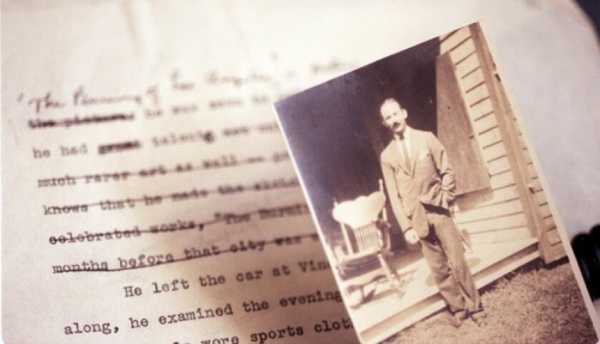 """A photo of Nathanael West with the manuscript for """"The Day of the Locust."""""""